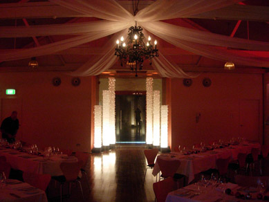 Magill Estate Draping with Black Chandelier & Light Columns
