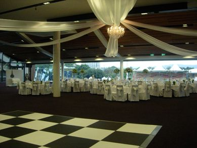 Adelaide Oval Organza Draping with Extra Large Chandelier & Silver Candelabra