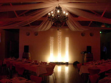 Magill Estate Draping with Black Chandelier & Light Columns 2
