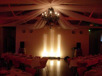 Draping with Black Crystal Chandelier & Light Columns